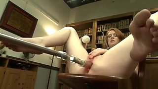 Pale babe in office fucks machine