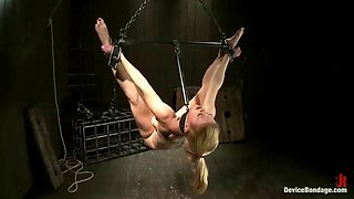 intense bondage device scene with big titty blonde