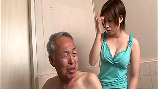 Salacious Asian chick with nice big tits sucking an old man's cock