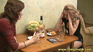 Two girls drink wine and talk