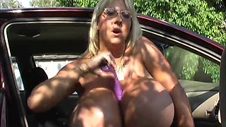 Mature with big tits masturbates by her car outside