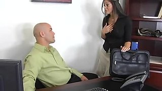 Busty brunette seduces her boss and fucks him in his office