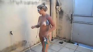 Horny naked wife washes after the beach