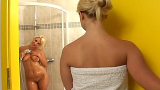 Lilith B and Sharon D lick each other's clits in the shower