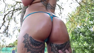 Mica martinez strips and has her oiled ass and big tits fondled by the camera man