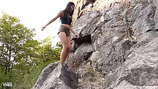 naughty lady dee toys herself with a corn during hiking in the mountains