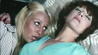 Two lesbians Cathy Stewart, Diane Dubois fondle each other and fuck cunts with toys