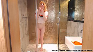 Innocent little blonde having a shower