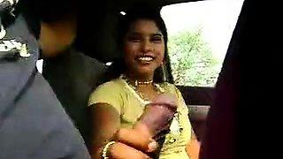 Kinky slut masturbates cock in a car
