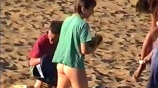 Nudist family leaving the beach
