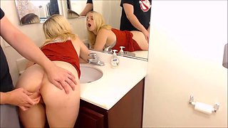 busty blonde gets fucked in the bathroom