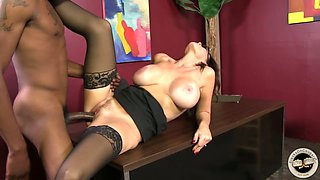 Busty stacked brunette in glasses Charlee Chase gets fucked in sideways pose on table