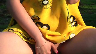 Sweet girl in yellow dress flashing her tight body and fingers her pussy outdoors