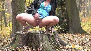 Dark haired pregnant slut sat on stub in woods and pissed