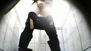 Blonde woman pissing in toilet