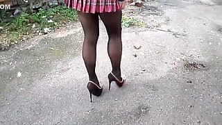 Nylon tights, high heel and school skirt
