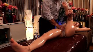 Buxom Oriental beauty gets sexually pleased by a masseur