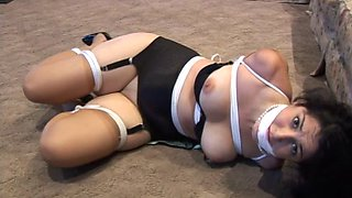 Hot bondage session with a black-haired mature slut