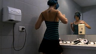 Exciting babe gets caught masturbating in a public toilet