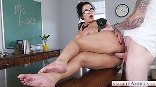 Curvy brunette teacher Sheridan Love fucks a horny stud
