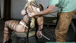mature bòonde ziptied in chair