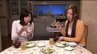 Kinky Japanese lesbian milfs enjoy fucking hardcore in the kitchen