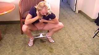 Blonde pees on hotel carpet