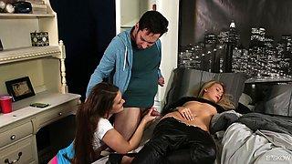Abby Cross chokes on a fellow's dick as a blonde is sleeping