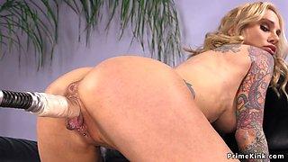 Huge tits blonde fucks machine on sofa