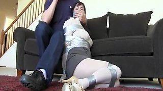 Horny neighbour tightly taped up and left writhing in white pantyhose