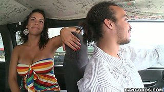 Brazen tanned brunette flaunts her big tits and sucks in bangbus
