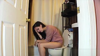 Brunette woman has diarrhea on private toilet
