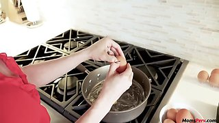 Mom blows while son while he is cooking!