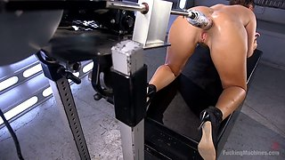 Crazy bitch Roxy Raye is testing a new sex machine and fisting her stretched anus
