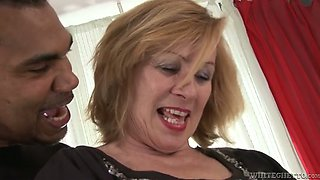 Light haired mature slut presents solid blowjob to black guy