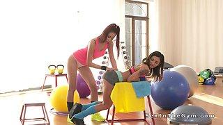 Perfect lesbian babes doing squats