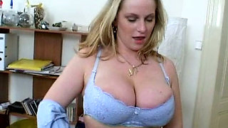Buxom housewife is toy fucked in a spicy porn clip