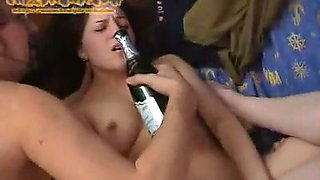 Two pretty brunettes share a dildo and suck a guy's wang