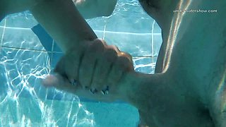 Horny bitch in swim glasses Candy gets fucked from behind in the pool