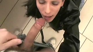 sexy brunette bitch enjoys to suck a lucky dude in the public toilets