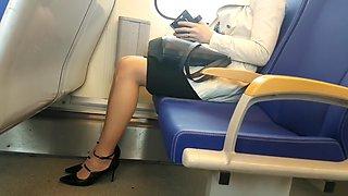 Young woman wearing nude pantyhose in train