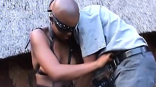 Bald African in leather bound and fucked
