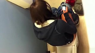 Girl spied over the toilet wall peeing