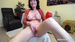Amazing milf enjoys fucking her ass with her finger