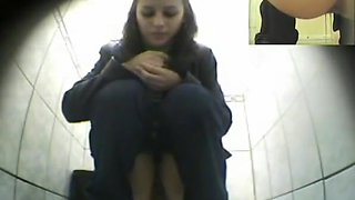 Cute chick peeing in public toilet