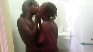 2 Horny African hotties fuck each ohter in the shower. They