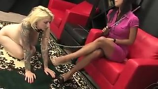 Mistress playing around with her lesbian doggy