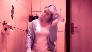 Woman using her toilet to take a piss