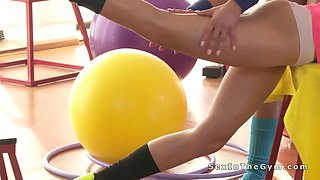 Lesbians licking and toying after workout