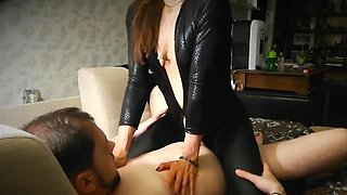Amazing reverse cowgirl in latex dress